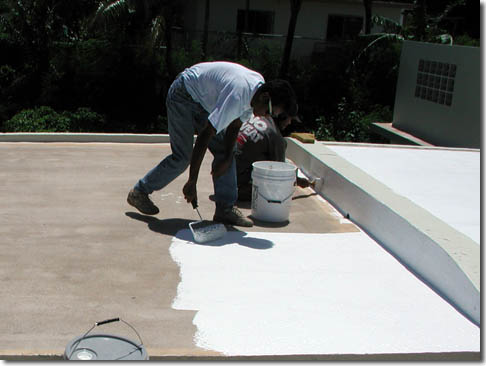 Roofer applying roof coating in Canon GA