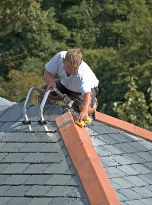 Roofer installing slate roof in Fair Play, SC.